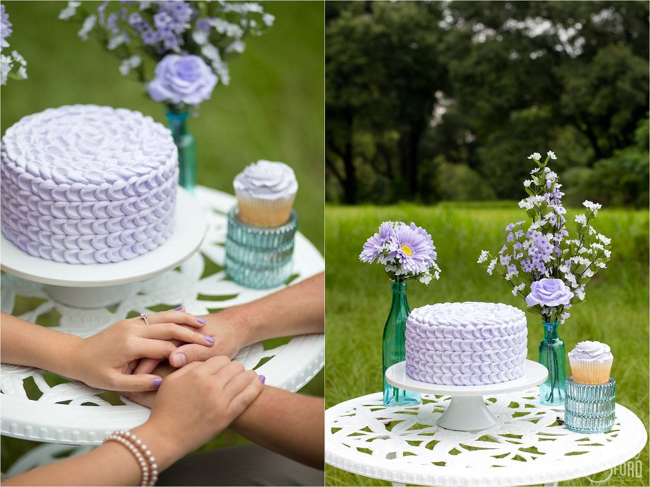 Cupcake themed engagement session with pastel colored cake and flowers with couple holding hands