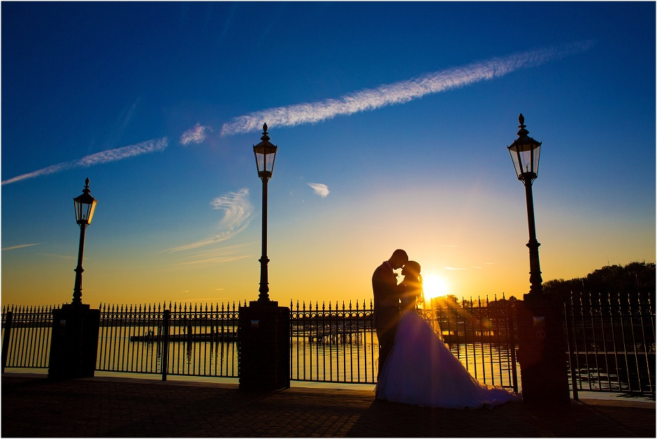 Bride and groom spending a quiet moment alone at sunset