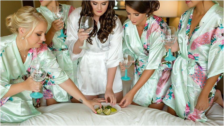 Bride & her bridesmaids in teal floral getting ready robes prepare for tequila shots