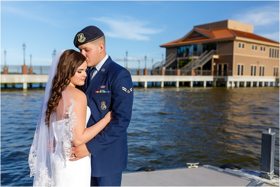 Bride & groom share a moment on the dock outside Tavares Pavilion