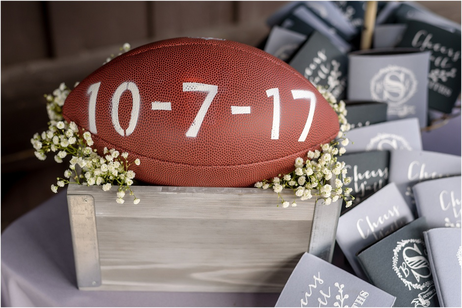 A football with their wedding date written on it welcomes guests
