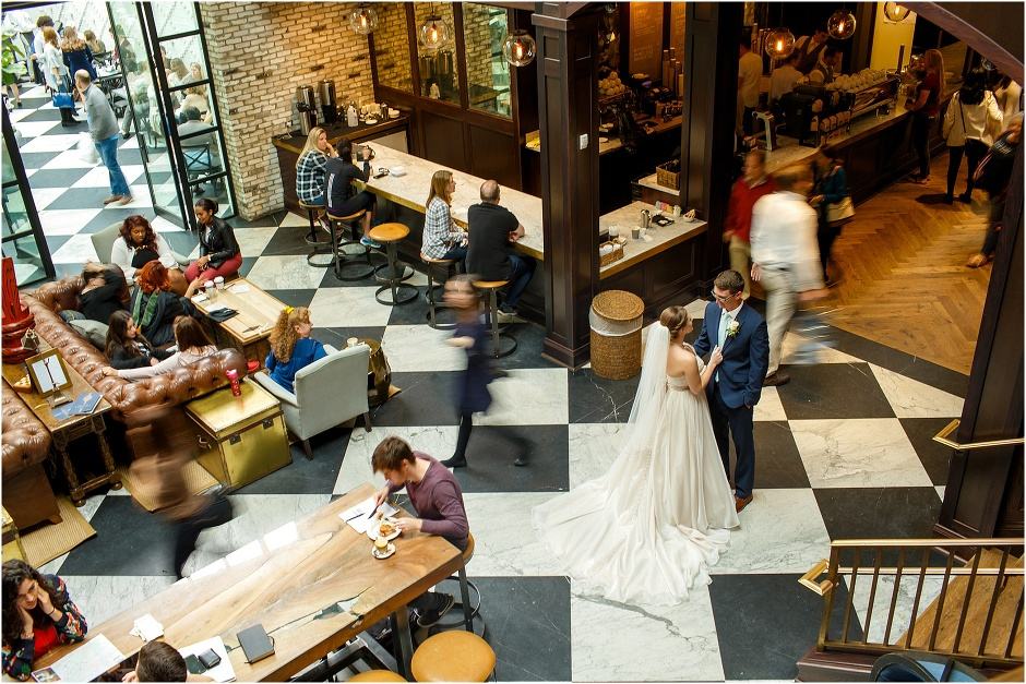 Bride & Groom frozen as the hustle and bustle of Oxford Exchange in Tampa swirls around them
