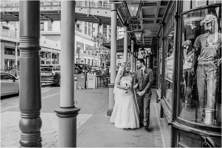 bride groom stroll arm in arm down historic church street in downtown orlando - Orchid Garden Orlando